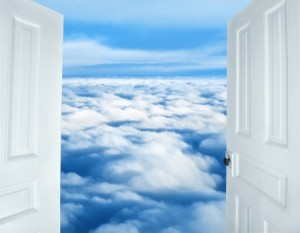 15845542 - doors opening to a heavenly sight of fluffy clouds